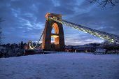 Suspension bridge snow evening
