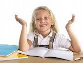Cute Little Schoolgirl Happy At Desk In Children Education Concept