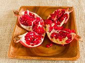 Open Pomegranate On Wooden Plate