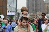 Little marcher gets a ride from dad