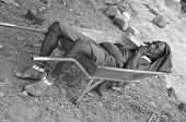 young Masai man sleep in a wheelbarrow
