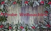 stock photo of weihnachten  - an old wooden background decorated with pine branches text frohe weihnachten - JPG