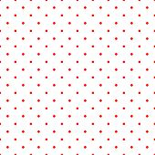 Seamless vector pattern with pink polka dots on a tile white background