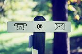 Computer Contact Icons Sign On Outdoor Signpost