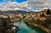 stock photo of yugoslavia  - Mostar Old Town View with Rebuilt Old Bridge - JPG