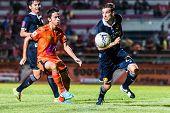 Sisaket Thailand-september 21: Piyawat Thongman Of Sisaket Fc. (orange) In Action During Friendly Ma