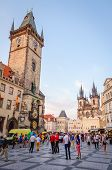 Tourists walking in front of Old Town Hall in Prague