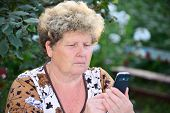 Middleaged woman talks on  mobile phone
