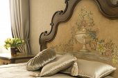 foto of old-fashioned  - bed with big headboard and tulips in vase - JPG