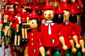 stock photo of fable  - Pinocchio white red and green goes to the market - JPG