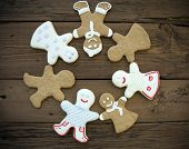 stock photo of ginger bread  - Many Different Happy Ginger Bread People Building a Circle Symbolizing Happiness and Community - JPG