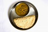 Black Chickpea gravy with Indian bread also called roti on an isolated background