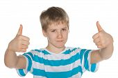 Preteen Boy Holds His Thumbs Up