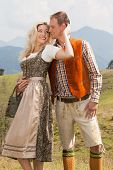 Young romantic couple in traditional Bavarian costumes