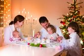 Happy Young Family At Christmas Dinner