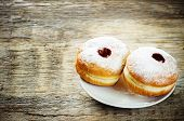 picture of hanukkah  - fresh doughnuts with jam on a dark wood background for Hanukkah - JPG