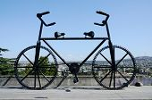 Gigantic bicycle statue with two handle bars and saddles on the Rose Revolution square in Tbilisi