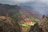 Waimea Canyon waterfall and rain storm