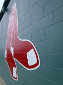 Red Sox Historic Baseball Logo Painted On A Green Brick Wall