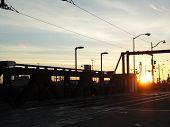 Sunset Over Bridge With Rail Tracks