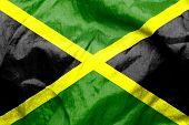 foto of jamaican  - Jamaican flag texture creased and crumpled up - JPG