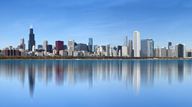 stock photo of willy  - View of downtown Chicago with dramatic reflection on Lake Michigan - JPG