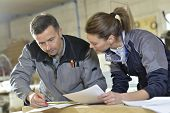 stock photo of carpentry  - Instructor with trainee in carpentry workshop - JPG