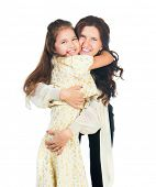 Cute little girl hugging her mother. Happy family.
