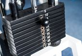 Stack of  metal weights in gym bodybuilding equipment