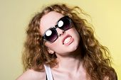 Pretty Young Capricious Beautiful Girl In Sunglasses
