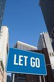 The word let go and blue billboard against new york