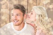 Attractive blonde whispering secret to boyfriend against light glowing dots design pattern