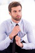Businessman Tying A Necktie