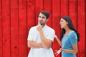 Angry brunette shouting at boyfriend against red wooden planks