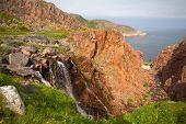 Big Northern Beautiful Waterfalls On The Seashore