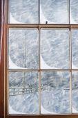 Old Georgian sash window overlooking snowy scene