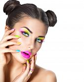 Beauty Girl Portrait with Colorful Makeup, Nail polish and ring Accessories. Colourful eyeshadows make-up. Studio Shot of Stylish Woman. Vivid Colors. Manicure and Hairstyle. Rainbow Colours