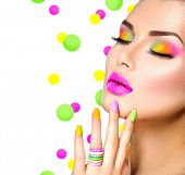 Beauty Girl Portrait with Colorful Makeup, Nail polish and ring Accessories. Colourful eyeshadows make-up. Studio Shot of Stylish Woman. Vivid Colors. Manicure, eyeshadow Rainbow Colours