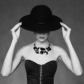 Fashion photo of beautiful lady in elegant black hat