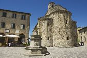 People enjoy lunch at the central square of San Leo medieval town in San Leo, Italy.