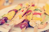 Prawns grilled with fruits - cajun style dish, toned image
