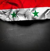 Syria waving flag on blackboard