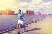 picture of scandinavian  - Urban man runner running in Copenhagen city - JPG