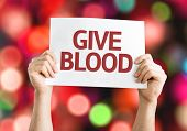Give Blood card with colorful background with defocused lights