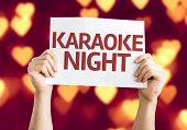 Karaoke Night card with heart bokeh background