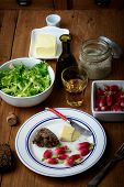 pic of radish  - plate with radish and butter on a table - JPG