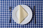 image of knife  - Meal setting on blue tablecloth - JPG
