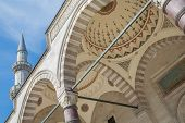 Decorated corridor ceiling and minaret in muslim mosque, Istanbul