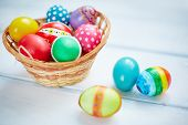 Decorative eggs of various colors in basket
