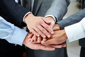 Business people hands on top of each other